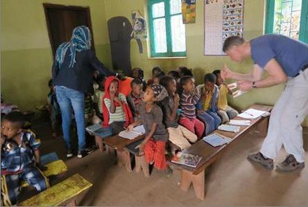 The dentists also visit the children in the local schools and clean their teeth