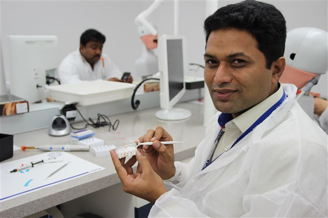 Dentists test VOCO's Amaris during the hands-on course.