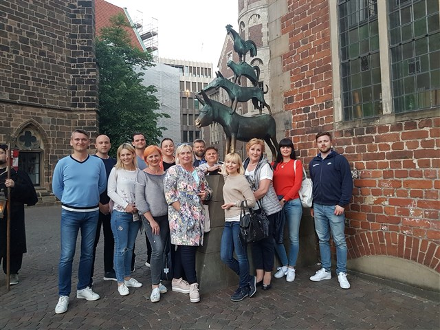 Visiting Bremen - infront of the statue of The Bremen town musicians